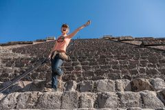 Happy  tourist climbing Pyramid of the Sun in Teotihuacan, Mexi Stock Photography