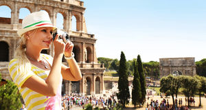 Happy Tourist and Coliseum, Rome. Cheerful Blonde with Camera. Happy Tourist and Coliseum, Rome. Cheerful Young Blonde Woman with Camera in Italy. Travel in Royalty Free Stock Photo