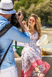 Happy Tourist Couple Enjoying City And Taking Photo Stock Photography