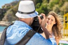 Happy Tourist Couple Enjoying City And Taking Photo Stock Images