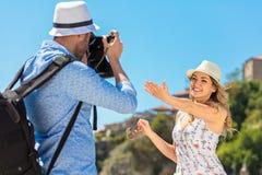 Happy Tourist Couple Enjoying City And Taking Photo Royalty Free Stock Image