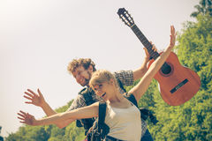 Happy tourist couple with guitar outdoor Stock Photo