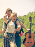 Happy tourist couple with guitar outdoor Royalty Free Stock Photo