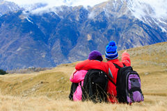Happy tourist couple hiking in mountains Royalty Free Stock Images