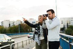 Happy tourist couple in love traveling Royalty Free Stock Images