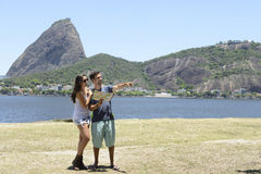 Happy tourist couple with map royalty free stock photo