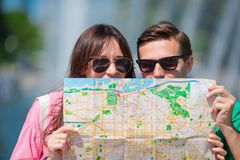 Young tourist friends traveling on holidays in Europe smiling happy. Closeup caucasian family with city map in search of. Happy tourist couple, men and women stock photos