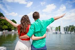 Young tourist couple traveling on holidays in Europe smiling happy. Caucasian girl and man background of fountain. Happy tourist couple, men and women traveling stock image