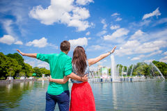 Young tourist couple traveling on holidays in Europe smiling happy. Caucasian girl and man background of fountain. Happy tourist couple, men and women traveling stock photos