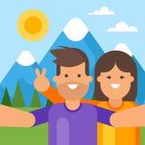 Happy tourist couple taking selfie behind the mountains. Stock Photo
