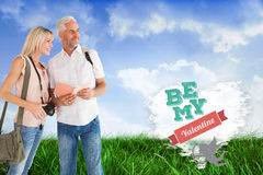 Happy tourist couple using the guidebook Royalty Free Stock Photo