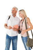 Happy tourist couple using the guidebook Royalty Free Stock Images