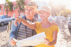 Happy tourist couple using map in the city Royalty Free Stock Images