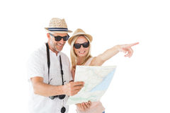 Happy tourist couple using map and pointing Stock Photography