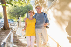 Happy tourist couple walking in the city royalty free stock photography