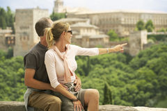 Happy Tourist Couple With Woman Pointing At View Stock Images