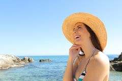 Happy tourist dreaming looking at side on the beach royalty free stock photos