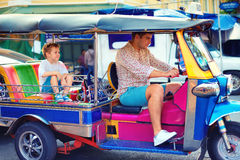 Happy tourist family having fun on traditional tuk-tuk taxi in asian city Royalty Free Stock Photography