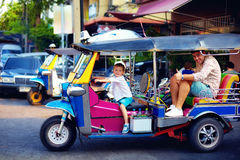 Happy tourist family having fun on traditional tuk-tuk taxi in asian city Royalty Free Stock Images