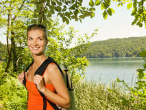 Happy tourist in a forest Stock Image