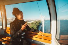 Happy tourist girl in a cableway car royalty free stock photo