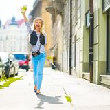 Tourist girl with map walking on city street Royalty Free Stock Images