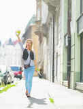 Happy tourist girl with map walking on city street Stock Images