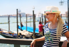 Happy Tourist and Gondolas in Venice, Italy. Cheerful Young Blon Royalty Free Stock Image