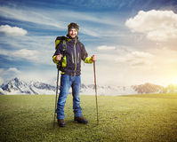 Happy tourist with hiker poles Royalty Free Stock Photo
