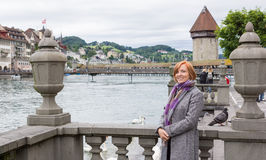 Happy tourist in Lucerne, Switzerland. Smiling tourist with Chapel bridge and city behind Stock Images