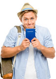 Happy tourist man holding passport isolated on white background Royalty Free Stock Photography