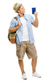 Happy tourist man holding passport isolated on white background Royalty Free Stock Photos