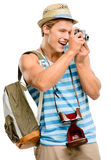 Happy tourist man photographing vintage camera isolated on white Royalty Free Stock Photography