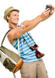 Happy tourist man photographing vintage camera isolated on white Stock Photos