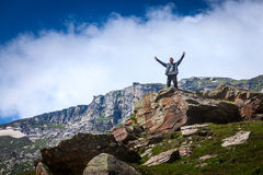 Happy tourist in mountains Royalty Free Stock Photo