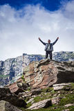 Happy tourist in mountains Royalty Free Stock Image