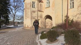 Happy tourist near the medieval castle stock footage