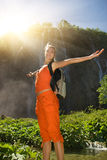 Happy tourist near waterfall Royalty Free Stock Photo