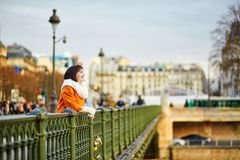 Happy tourist in Paris on a winter or spring day Stock Photos