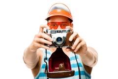 Happy tourist photographer taking photo Stock Photo