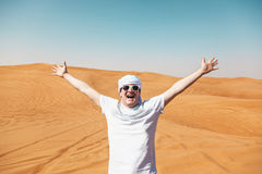 Happy tourist in Safari Desert. Cheerful happy tourist guy in Safari Desert stock image