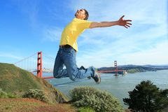 Happy tourist in San Francisco. Happy young man jumping high in the air next to the Golden Gate bridge, San Francisco, California Stock Photo