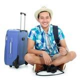 Happy tourist sitting on the floor Stock Image