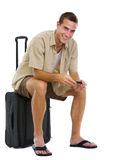 Happy tourist sitting on wheels bag Royalty Free Stock Photo