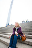 Happy Tourist at the St. Louis Gateway Arch. A tourist at the Gateway Arch and an interesting view of the St. Louis Arch - Gateway to the West - the Jefferson royalty free stock image
