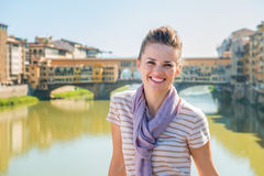 Happy tourist standing on the bridge overlooking Ponte Vecchio Royalty Free Stock Images