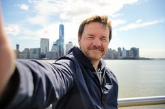 Happy tourist taking a self portrait in New York City Stock Images