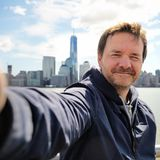 Happy tourist taking a self portrait in New York City Royalty Free Stock Photo