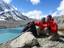 Happy tourist and Tilicho lake, Tilicho peak, Nepal Stock Images