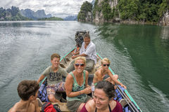 Happy tourist traveling on a boat Royalty Free Stock Photo